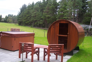 Log cabin with barrel sauna speyside scotland
